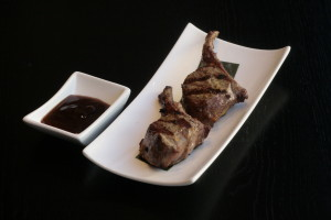 F5 Yang Pai Lamb chops served with soy sauce.