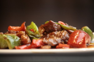 G7 Hoi Kwo Niu Rou Beef in soy paste sauce, Szechuan peppers, paprika, onions and bamboo.