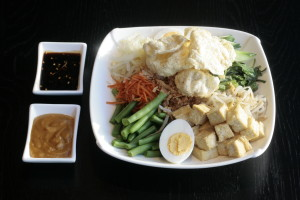 I4 Gado Gado White cabbage, bean sprouts, cucumber, string beans, water spinach, tofu, egg, fried onions, Emping Melindjo, spicy sweet soy sauce and peanut sauce.