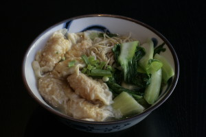 J3 Siu Kao Thong Min Noodle soup with shrimp dumplings, vegetables ad chicken broth.