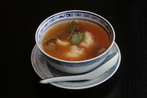 A4 Tom Yam Kung Spicy Thai prawn soup with mushrooms and lime leaves.