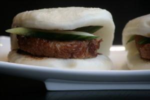 C1 Siu Ab Bao Roasted duck on a steamed Mandarin bun, served with cucumber and hoisin sauce.