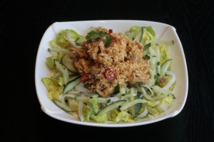 I1 Bang Bang Ji Chicken, rice noodles, cucumber, pickled radish, carrot, baby gem and sesame dressing.