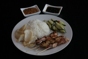 K5 Sate Platter 2 chicken saté, 2 pork saté, 2 prawn saté, Acar Ketimun, Kerupuk Udang, spicy sweet soy sauce and peanut sauce with steamed rice, fried rice, fried noodles or fried rice noodles of your choice.